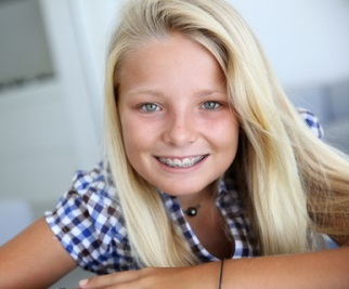 https://www.dreamstime.com/royalty-free-stock-images-teen-braces-portrait-smiling-blond-teenager-image30582949