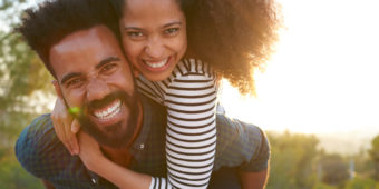 Couple Smiling After Avoiding Dental Decay Promoting Food