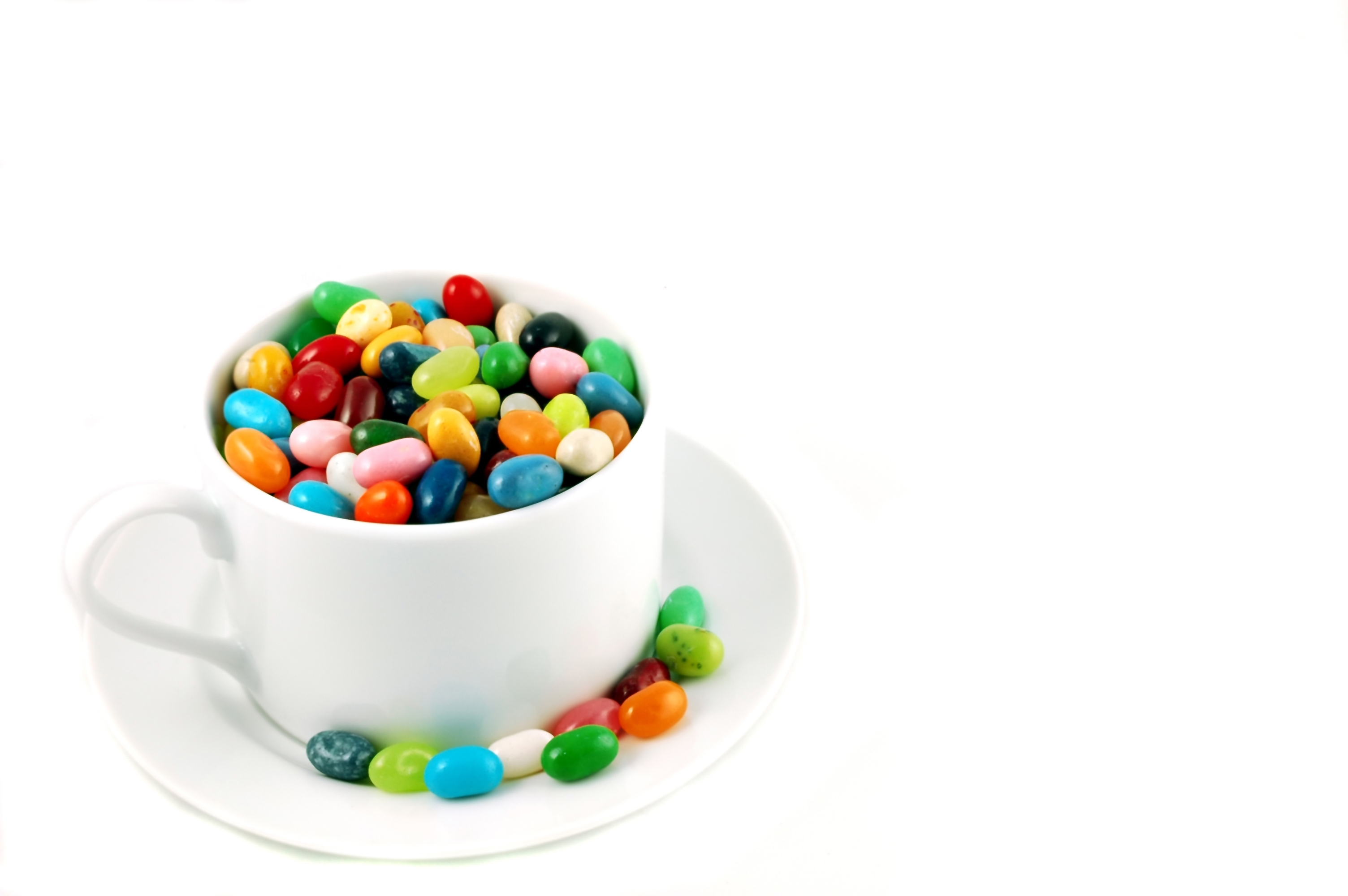 Unhealthy jelly beans in a white cup
