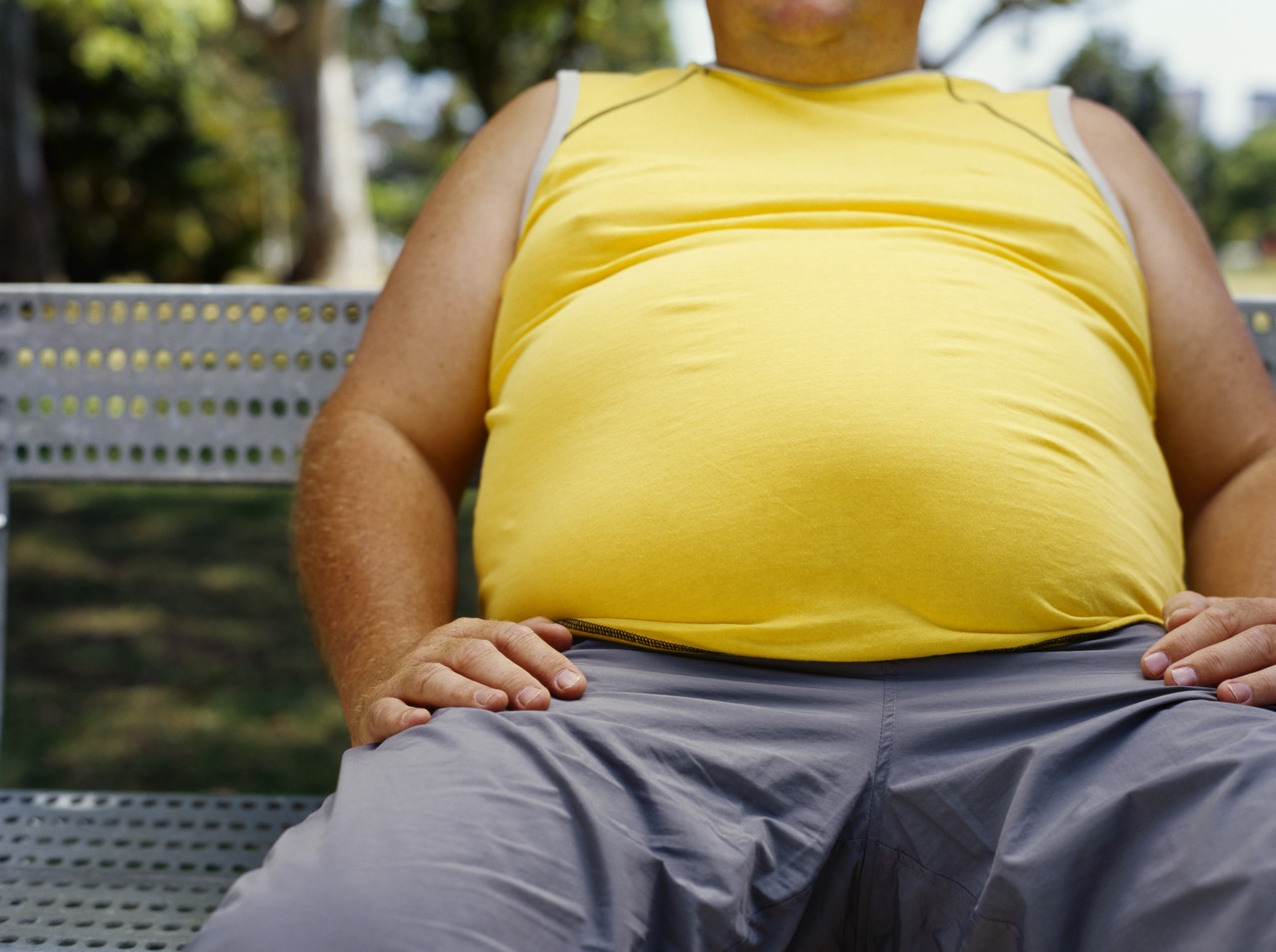 Obesity not healthy for man sitting on bench