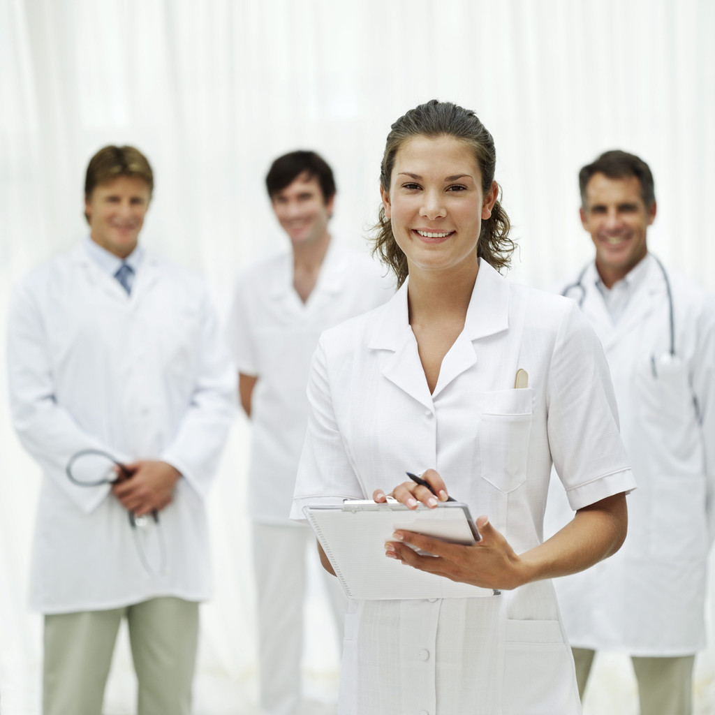 Dentists in lab coats with clipboard