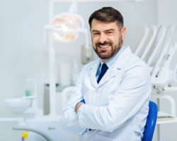 smiling bearded dentist