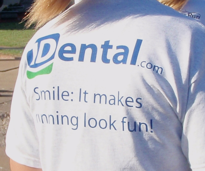 1Dental T-shirt - Smile: It makes running look fun!