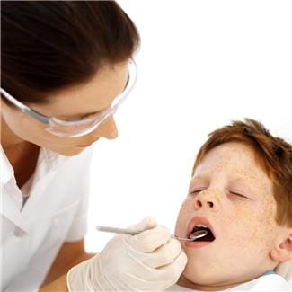 dentist with kid