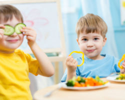 Cute Little Boys Eating Colorful Vegetables
