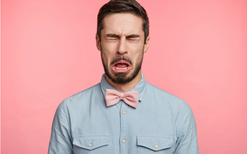 Man with Pink Bowtie Making Sour Face