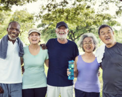 Group of Healthy Active Retirees Laughing Outdoors