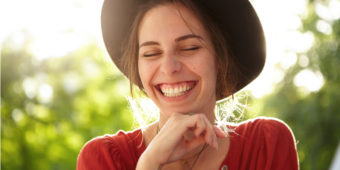 Woman with Hat Smiling in Sunshine